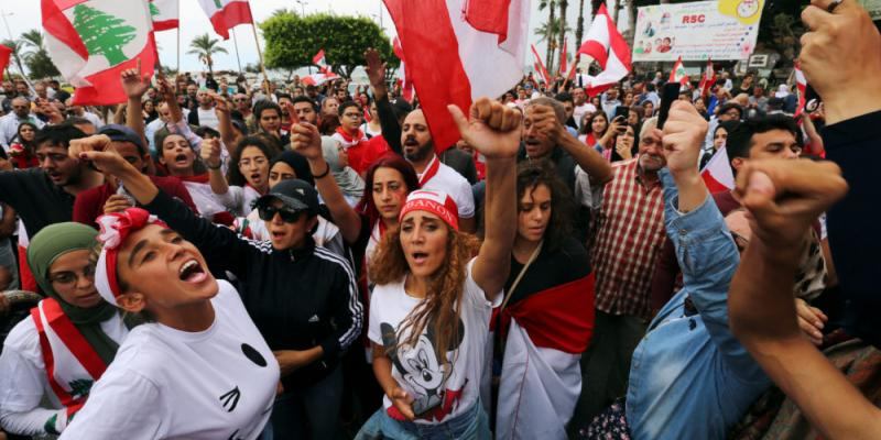 Demonstrators gesture and chant slogans during an anti-government protest in the southern city of Tyre